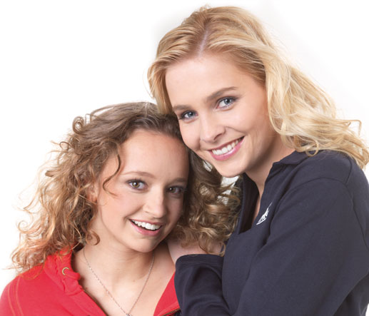 A women and her daughter both smiling whilst wearing incognito braces